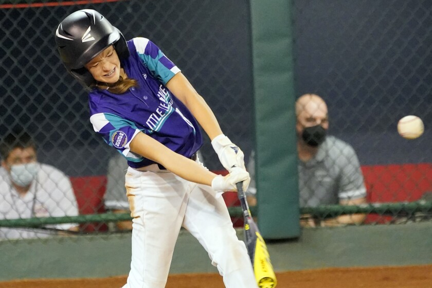 Texas' Ella Bruning connects for an RBI-single against Washington on Aug. 20 in South Williamsport, Pa.
