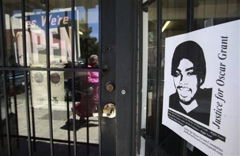 """A """"Justice for Oscar Grant"""" poster is shown at a shoe store in Oakland, Calif., Thursday, July 1, 2010."""