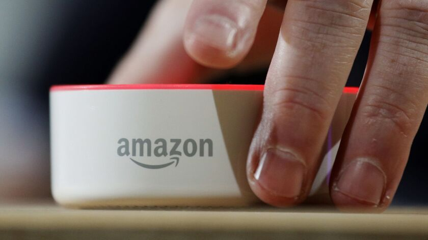 FILE - In this Wednesday, Sept. 27, 2017, file photo, an Amazon Echo Dot is displayed during a progr