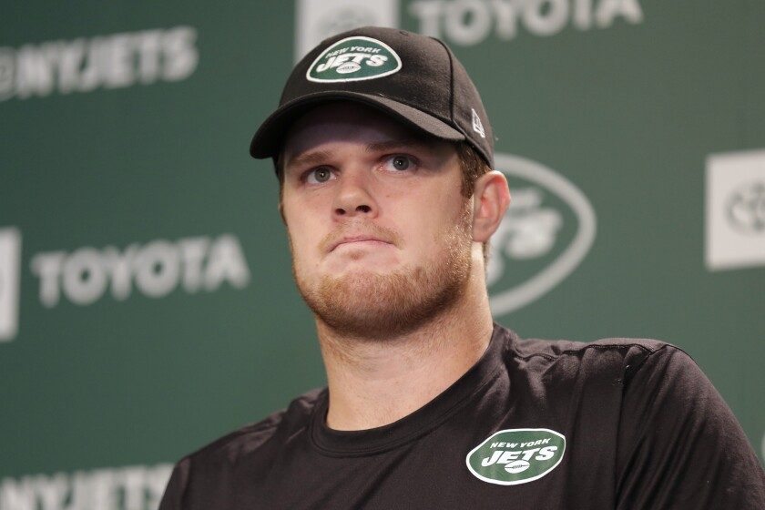 FILE - In this May 23, 2019, file photo, New York Jets quarterback Sam Darnold speaks to reporters after an NFL football practice in Florham Park, N.J. Darnold has been ruled out for New York's game at Philadelphia on Sunday as he continues to recover from mononucleosis. Coach Adam Gase says Friday that Darnold had tests Thursday night, and the results of which were not sufficient enough for doctors to clear him to play. (AP Photo/Seth Wenig, File)
