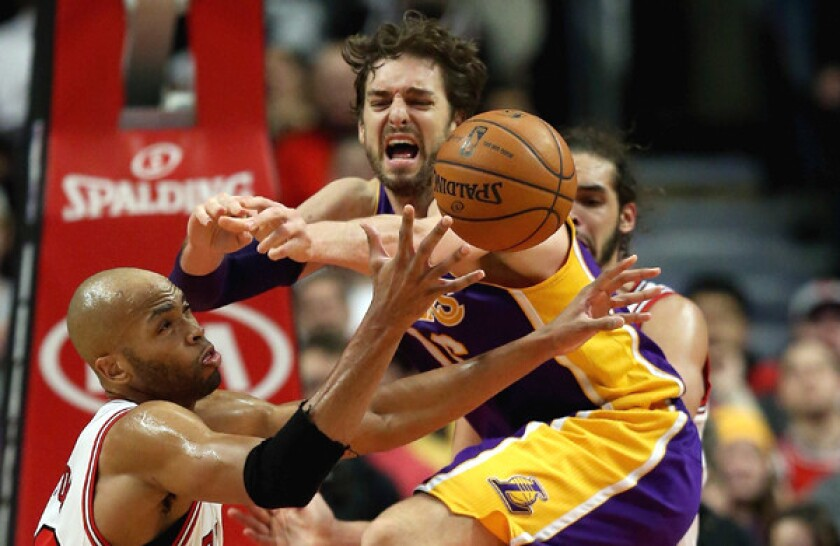 Chicago's Taj Gibson, left, grabs a loose ball in front of Lakers center Pau Gasol during a game on Jan. 20. Gasol's tenure with the Lakers could be coming to an end soon.