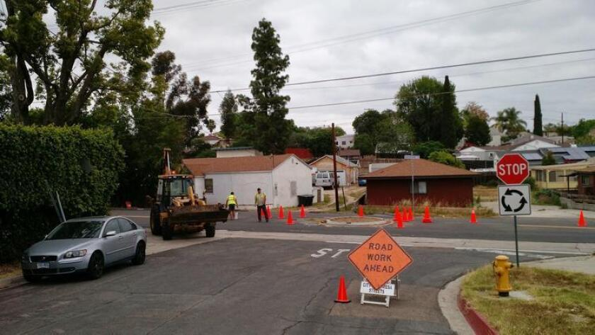 City workers in La Mesa get ready to remove the roundabout at Watson Way and Harbinson Avenue. The roundabout on Harbinson at Annapolis Avenue was also taken out this week