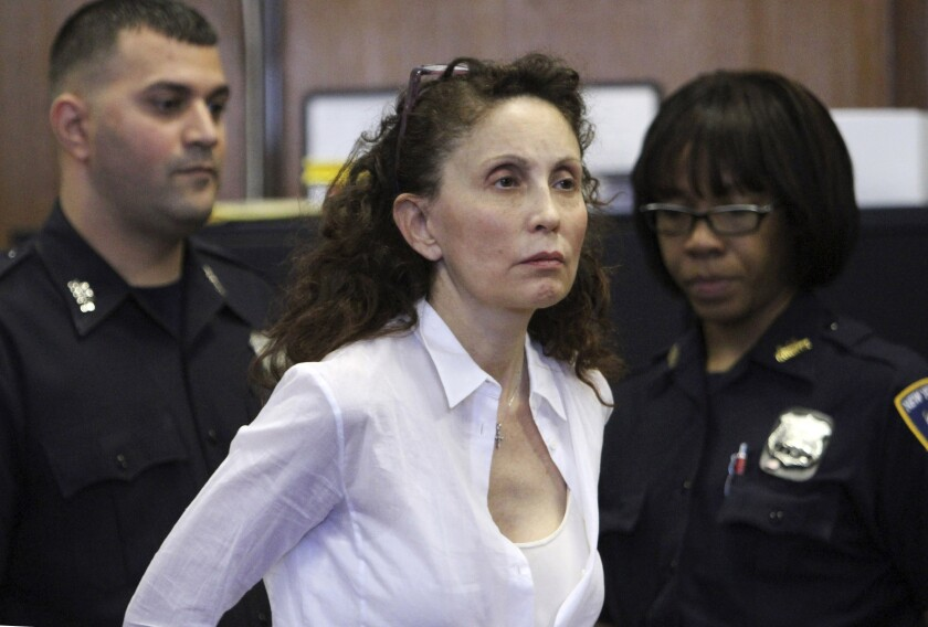 FILE - In this Aug. 11, 2011, file photo, Gigi Jordan, the multimillionaire mother charged with killing her autistic 8-year-old son, appears in Manhattan Supreme court in New York. On Friday, Sept. 25, 2020, a federal judge ordered a new trial for a self-made health care millionaire who was convicted six years ago of fatally drugging her 8-year-old autistic son in a luxury New York City hotel room in 2010. (AP Photo/Mary Altaffer, File)