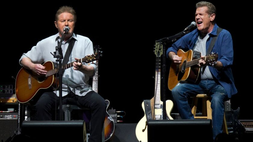 INGLEWOOD, CA - JANUARY 15, 2014: The Eagles Don Henley,left and Glenn Frey perform an opening song