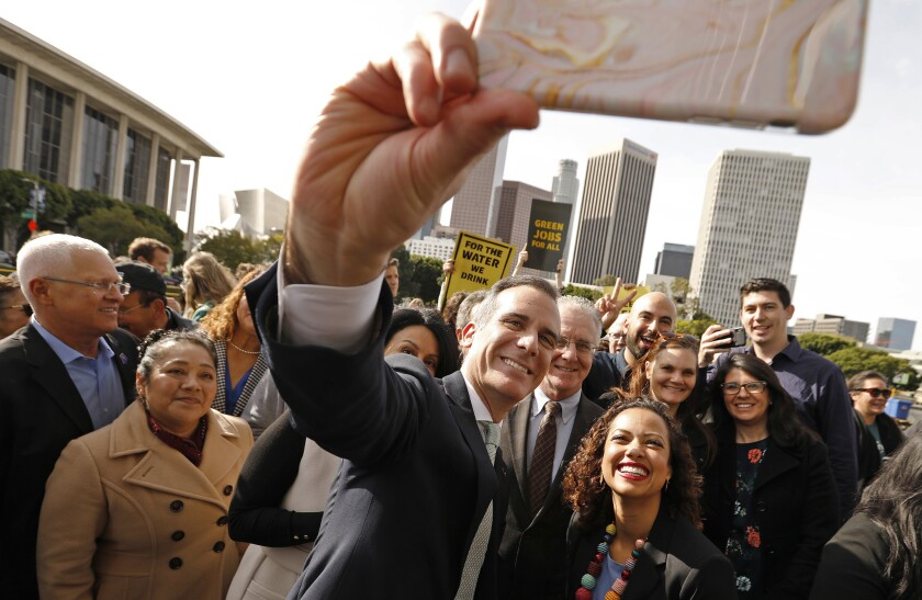 "LOS ANGELES, CA - FEBRUARY 12, 2019 Los Angeles Mayor Eric Garcetti, left takes a ""selfie"" with A"