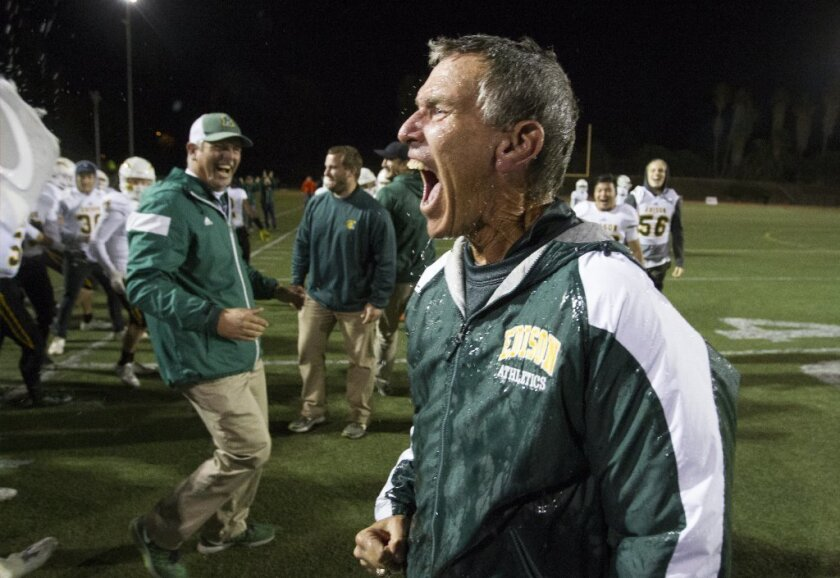 Edison's head coach Dave White celebrates after getting soaked following a 44-24 win over La Mirada in the CIF Southern Section Division 3 championship game on Friday.