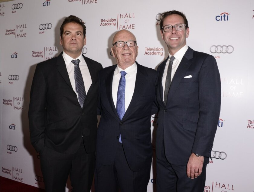 Rupert Murdoch with sons Lachlan (left) and James
