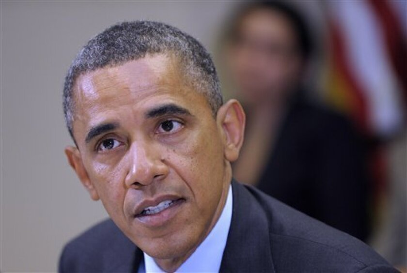 President Barack Obama makes a statement on the ongoing efforts on the drought during a meeting of the White House Rural Council in the Roosevelt Room at the White House in Washington, Tuesday, Aug. 7, 2012. (AP Photo/Susan Walsh)