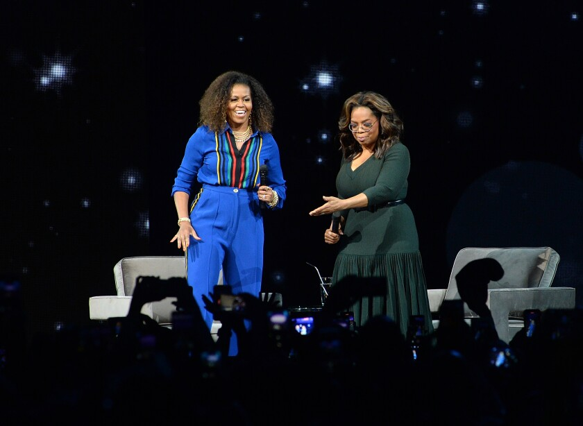 """Michelle Obama, left, and Oprah Winfrey participate at """"Oprah's 2020 Vision: Your Life in Focus"""" tour at the Barclays Center on Saturday, Feb. 8, 2020, in New York. (Photo by Brad Barket/Invision/AP)"""