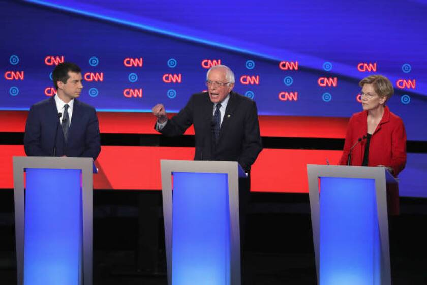 Democratic presidential candidates Sen. Bernie Sanders (I-VT) (C) speaks while Sen. Elizabeth Warren (D-MA) and South Bend, Indiana Mayor Pete Buttigieg (L) listen at the beginning of  the Democratic Presidential Debate in July. A contribution to Sanders has created controversy in California.