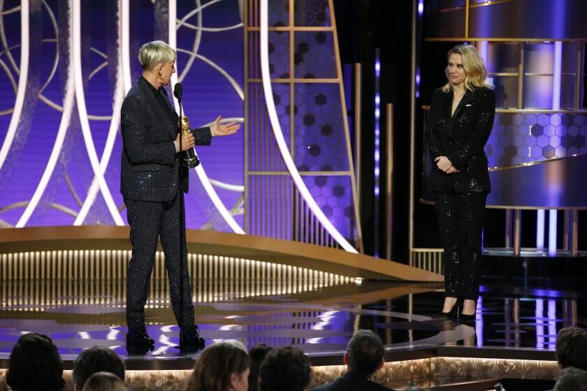 Ellen DeGeneres accepts the Carol Burnett TV Achievement Award as presenter Kate McKinnon looks on at Sunday's Golden Globes.