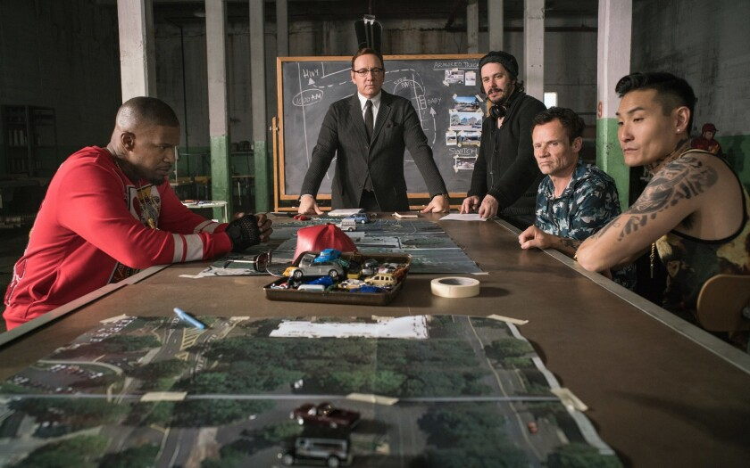 "Jamie Foxx, from left, Kevin Spacey, director Edgar Wright, Flea Balzary and Lanny Joon are shown on the set of ""Baby Driver."""