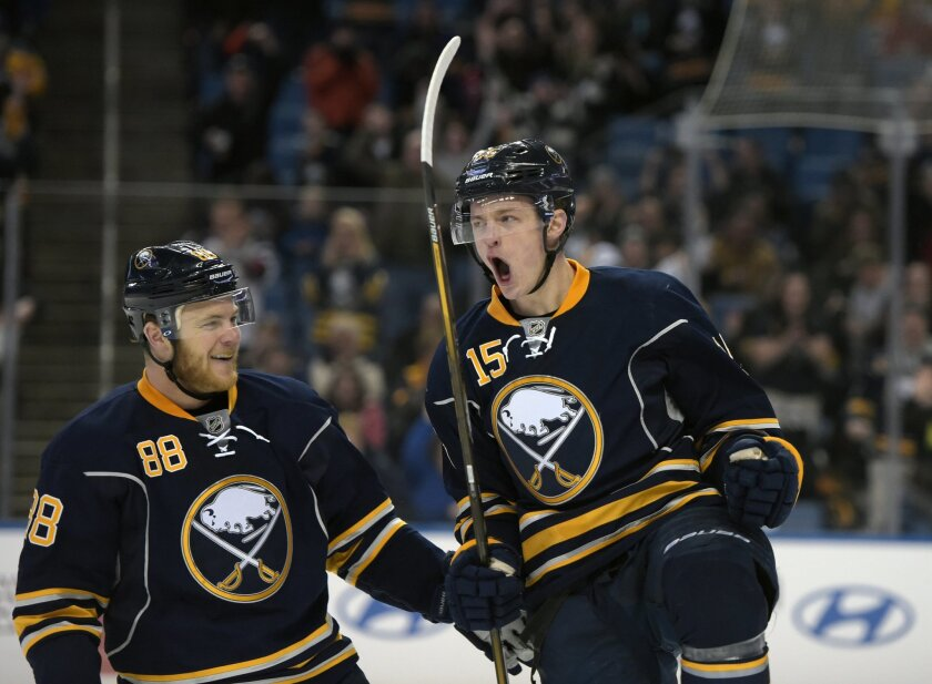 Buffalo Sabres' Jamie McGinn (88) celebrates with Jack Eichel (15) after Eichel scored during the first period of an NHL hockey game against the Colorado Avalanche, Sunday, Feb. 14, 2016, in Buffalo, N.Y. (AP Photo/Gary Wiepert)