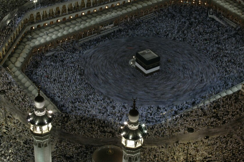 Hajj pilgrims in Mecca, Saudi Arabia, crowd inside the massive Grand Mosque and flood the surrounding streets