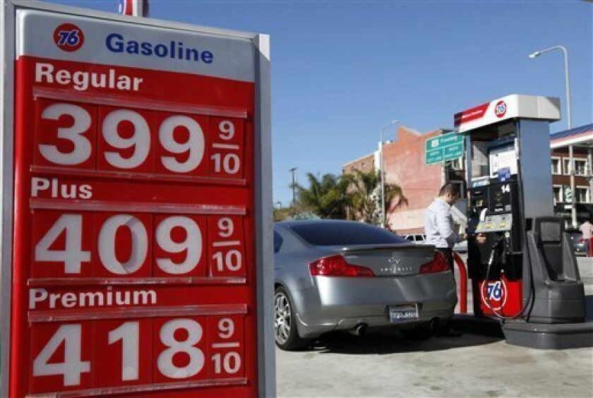 A man buys gas at a station Thursday Jan. 31, 2013 in Los Angeles. (AP Photo/Nick Ut)