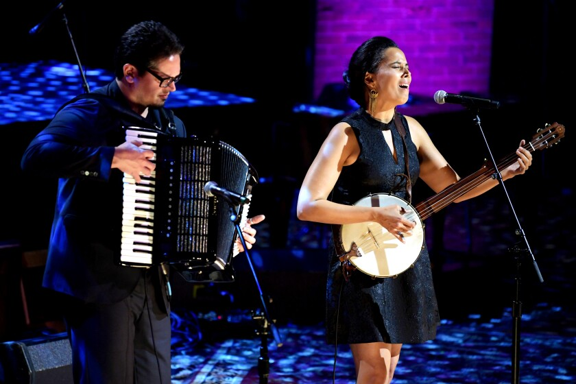 Francesco Turrisi, playing the accordion, and Rhiannon Giddens, singing and playing the banjo.