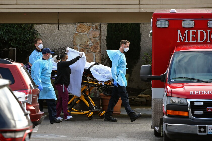A patient at the Life Care Center in Kirkland, Wash., is transferred into an ambulance Saturday.