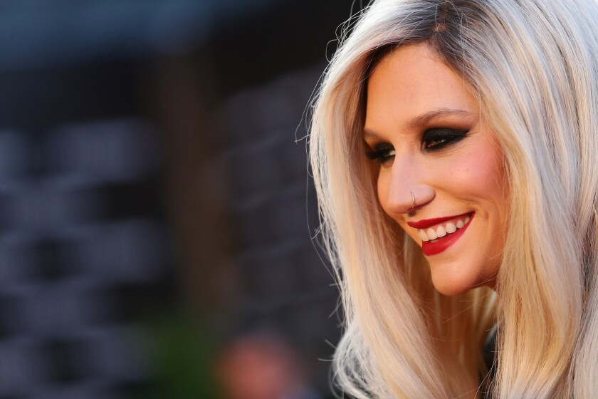 Kesha postpones tour dates
