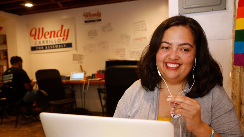 Wendy Carrillo, a candidate for the California Assembly District 51 seat, calls voters at her campaign's headquarters in Los Angeles in September.