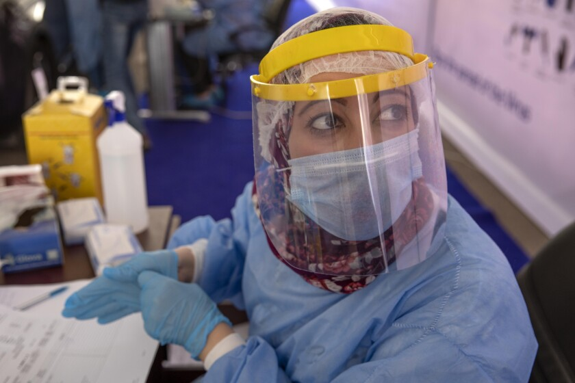 Health worker wearing protective gear in Cairo