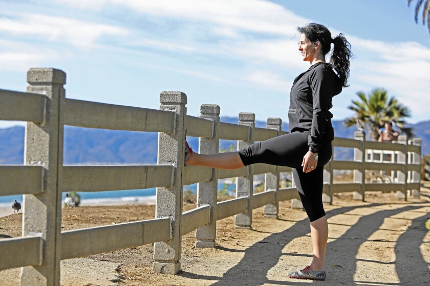 Trainer Amanda Joyce finds a beautiful spot for a hamstring stretch at Santa Monica's Palisades Park overlooking the ocean.