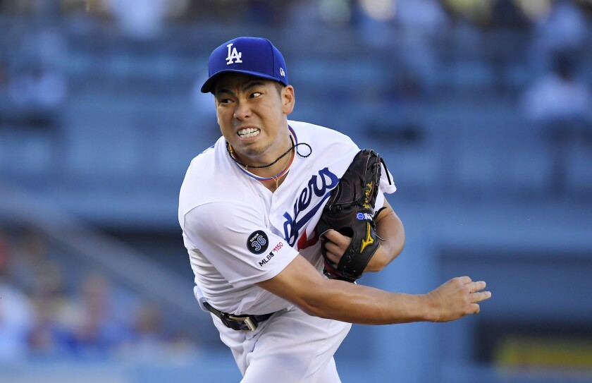 Dodgers starting pitcher Kenta Maeda throws to the plate during the first inning against the Arizona Diamondbacks.