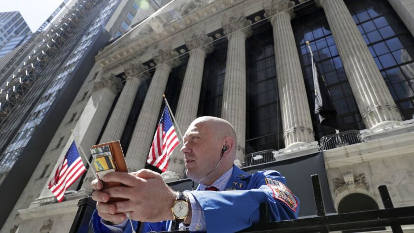 Vincent Pepe enjoys some fresh air last month outside the New York Stock Exchange where he works.