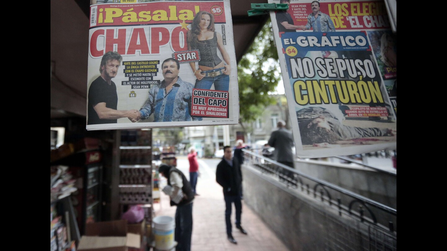 """A newspaper shows a picture of drug lord Joaquin Guzman, aka """"El Chapo,"""" shaking hands with actor Sean Penn, left, as seen at a newsstand in Mexico City on Sunday."""