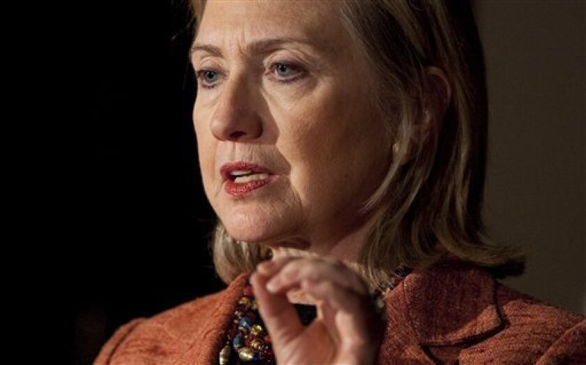 U.S. Secretary of State Hillary Rodham Clinton gestures during a news conference with Australian Foreign Minister Kevin Rudd on Saturday, Nov. 6, 2010 in Melbourne, Australia. (AP Photo/Evan Vucci, Pool)