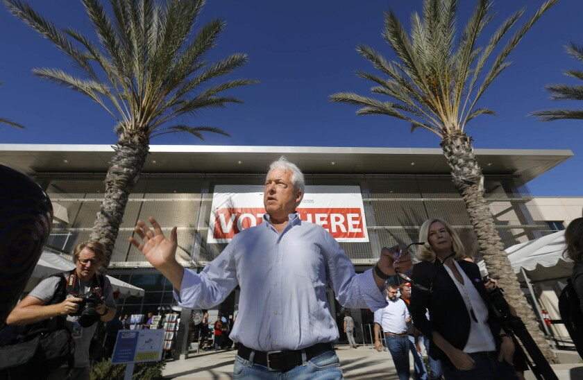 John Cox, a former Republican candidate for California governor, is shown in 2018 leaving the San Diego County Registrar of Voters office after dropping off his mail-in ballot.