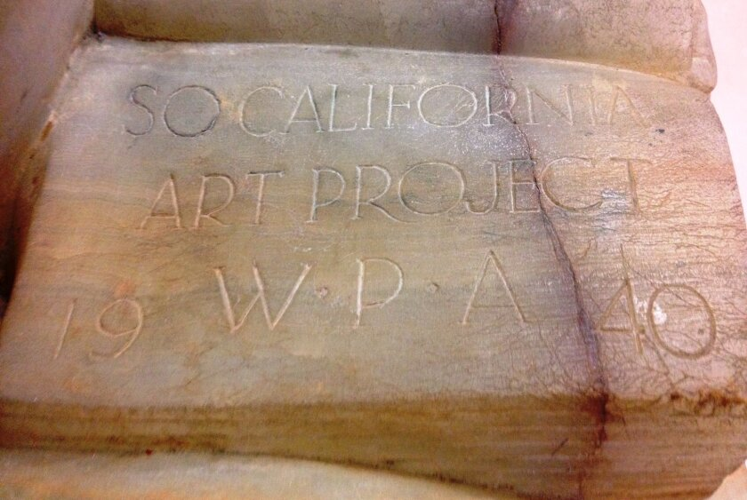 "Carved letters on the pages of the book in the lap of Donal Hord's ""Girl Reading"" sculpture say: ""So California Art Project WPA 1940."""