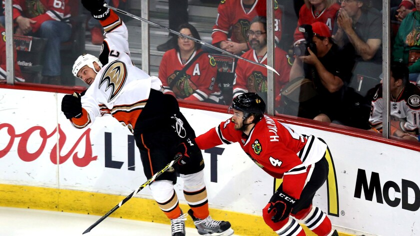Ducks center Ryan Getzlaf is sent reeling by a check from Blackhawks defenseman Niklas Hjalmarsson during Game 6 on Wednesday night in Chicago.