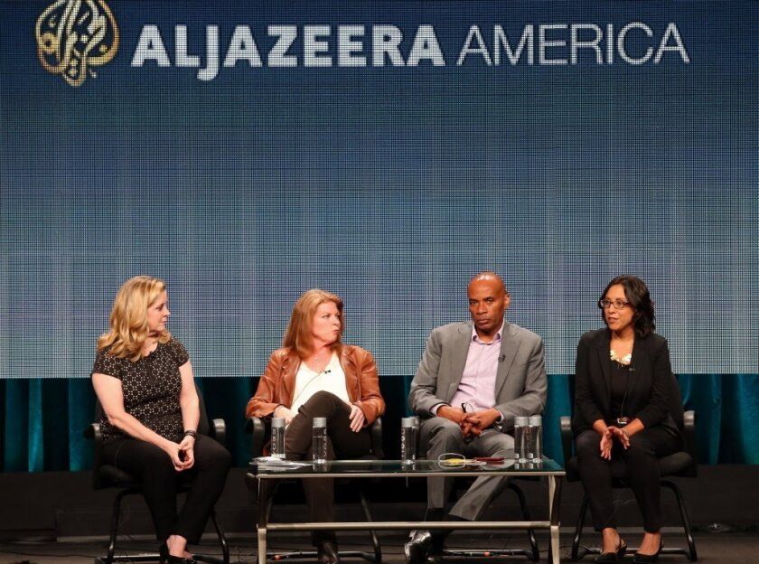 Al Jazeera America President Kate O'Brian, from left, attends the 2014 Summer Television Critics Assn. at The Beverly Hilton with Shannon High, the news network's senior vice president; nnchor and filmmaker Tony Harris; and producer Carrie Lozano.