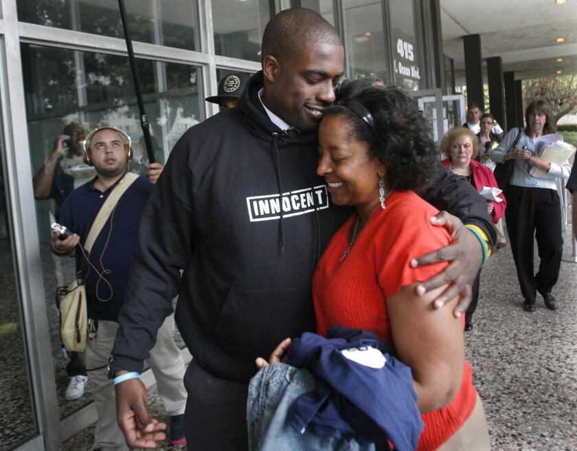Former Long Beach high school football star Brian Banks hugs his mother, Leomia Myers, outside the Long Beach courthouse after his rape conviction was overturned.