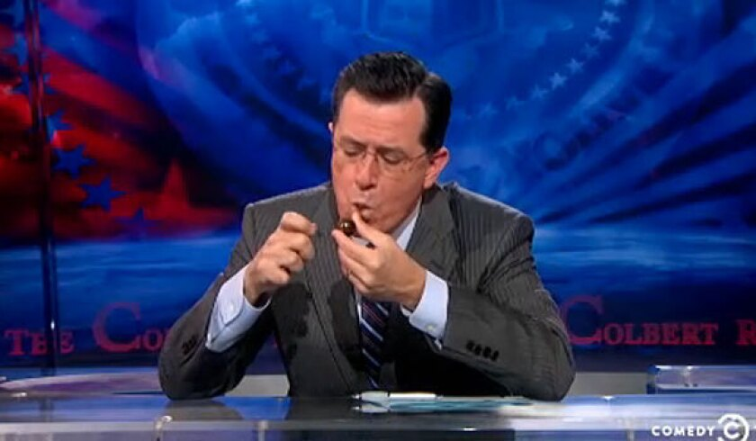 "Stephen Colbert smokes ""crack"" on ""The Colbert Report."""