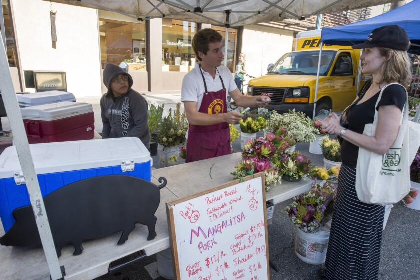 Oliver Woolley sells pork and flowers raised in Valley Center.