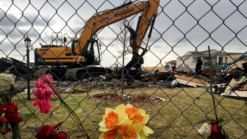 Heavy equipment moves debris from the site of a house explosion April 17 in Firestone, Colo., which killed two people.