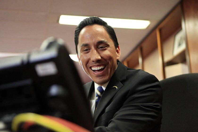 Interim mayor Todd Gloria reacts to hearing his Denver counterpart Michael B. Hancock.