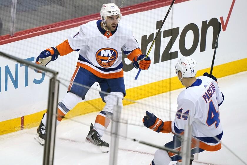 New York Islanders' Kyle Palmieri celebrates with Jean-Gabriel Pageau after scoring.