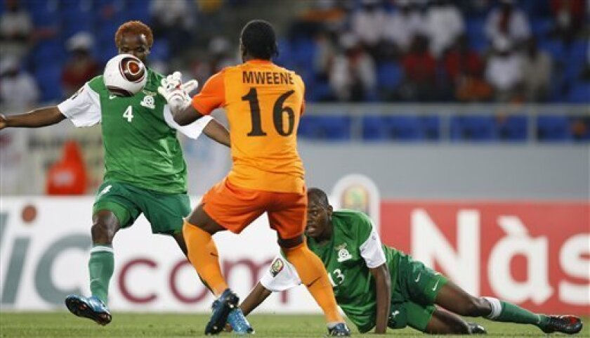 Zambia goalkeeper Kennedy Mweene and defenders Joseph Musonda, left, and Stophira Sunzu stop a Tunisian shot during their African Cup of Nations Group D soccer match at Tundavala Stadium in Lubango, Angola Wednesday, Jan. 13, 2010. (AP Photo/Rebecca Blackwell)