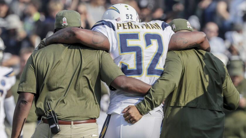 Chargers linebacker Denzel Perryman is helped off the field after sustaining an injury to his left knee.