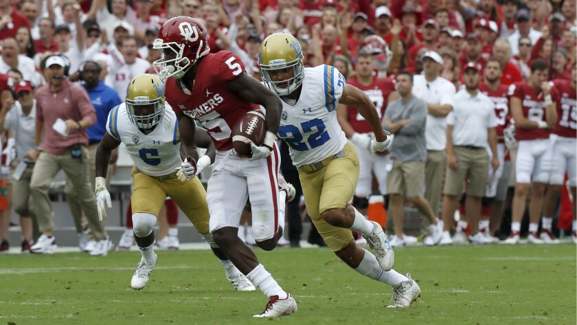 Oklahoma receiver Marquise Brown breaks away for a touchdown catch and run against UCLA in the first quarter.