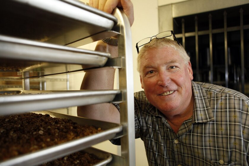 Trained as a CPA, Curtis Moore used to work as a chief financial officer for various companies. Now he makes granola and is selling it in a growing number of independent and natural food stores. He's pictured in the commercial kitchen he rents in El Cajon.