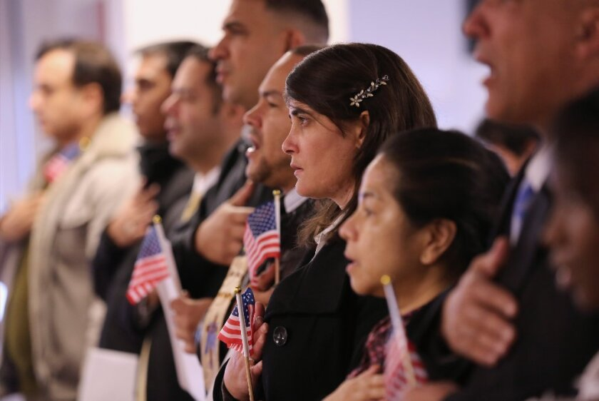 Immigrants take the oath of citizenship to the United States on Nov. 20 in Newark, N.J.