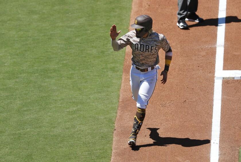 Fernando Tatis Jr. heads home after hitting home run Sunday against Arizona at Petco Park.