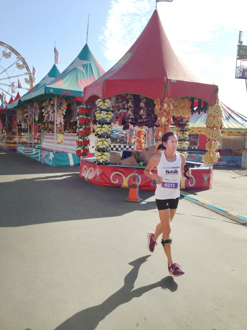 La Jolla resident Cheryl Hile (pictured at the San Diego County Fair 5K) uses an Ankle Foot Orthotic to help her run without full function in her legs due to Multiple Sclerosis (MS).