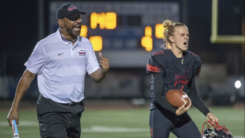 Former USC running backs coach Todd McNair, now an offensive line coach at Village Christian, cheers after a third-down stop late in the second quarter in Burbank on Friday.