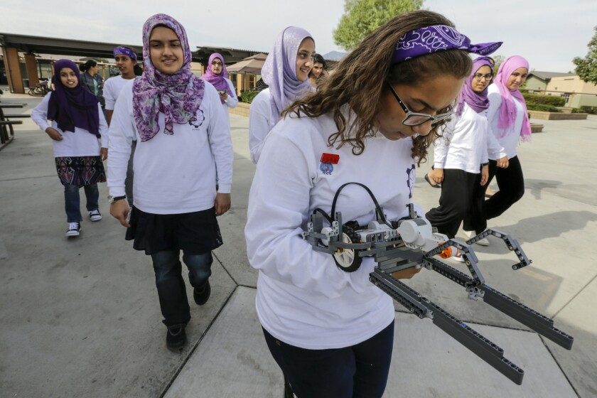 FemSTEM team member Salma Rashad tests one of the attachments on the way into competition.
