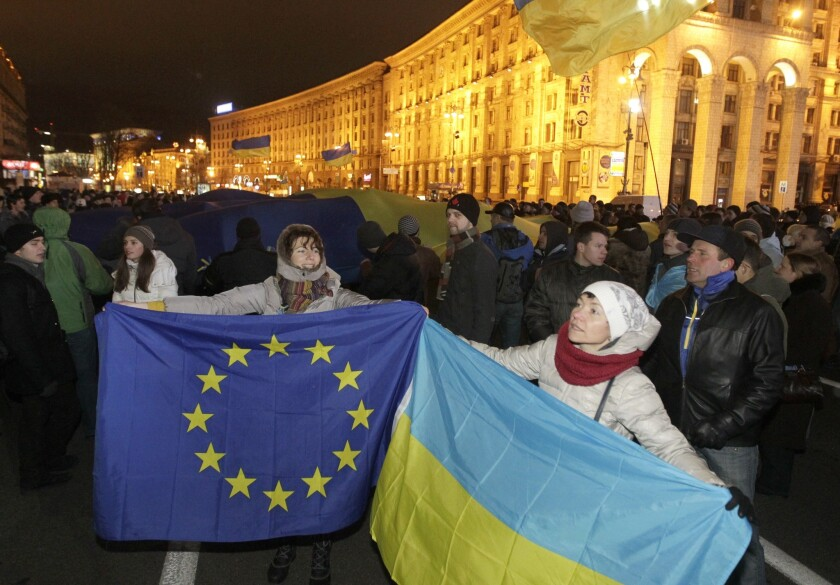 """Ukrainians in favor of closer ties with the European Union protest President Viktor Yanukovich's decision to """"pause"""" Ukraine's negotiations with the EU and focus instead on better trade relations with Russia."""