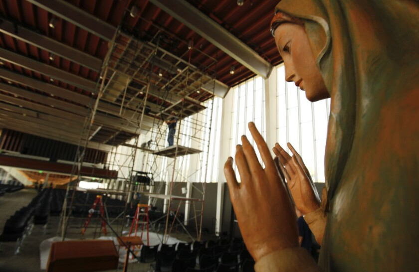 A statue of the Virgin Mary watches over the renovation underway at the Arboretum on the grounds of the former Crystal Cathedral in Garden Grove on July 25, 2013.